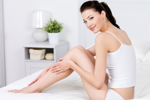 woman-touching-legs